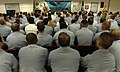 US Navy 050913-N-2383B-170 Chief of Naval Operations (CNO) Adm. Mike Mullen, top left, accompanied by the Master Chief Petty Officer of the Navy (MCPON) Terry Scott answers questions from junior enlisted Sailors.jpg