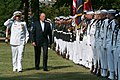 US Navy 050919-N-2383B-047 His Majesty King Harald V of Norway is escorted by Commanding Officer, U.S. Navy Ceremonial Guard, Cmdr. Scott Chapman, during a full honor ceremony.jpg