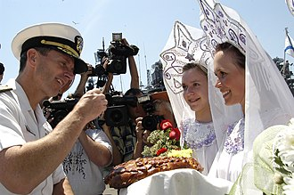 Bread and salt - US Naval officer takes part in a bread and salt ceremony after arriving in Vladivostok, Russia, July 3, 2006.