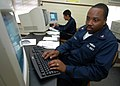 US Navy 070214-N-0879R-001 Information Systems Technician 2nd Class Frederick Marshall, assigned to guided missile destroyer USS Hopper (DDG 70), gets hands-on information technology (IT) training.jpg