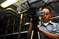 US Navy 070309-N-9928E-031 Mass Communication Specialist Seaman Leah Allen films a weapons exercise in weapons department's ordnance assembly division workshop.jpg