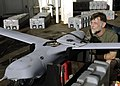 US Navy 070417-N-4790M-005 John J. Nicholson, a field service representative from Boeing, prepares Unmanned Aerial Vehicle (UAV) Scan Eagle for a mission to assess damage from an earthquake and tsunami.jpg