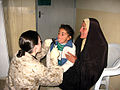 US Navy 070515-N-0000X-005 Hospital Corpsman 1st Class Anne M. DaSilva examines a four-year-old Iraqi girl during a Coordinated Medical Engagement following a vehicle borne improvised explosive device attack.jpg