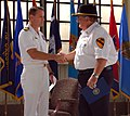 US Navy 071110-N-2425D-010 Capt. Jack Scorby Jr., commanding officer of Naval Air Station Jacksonville, thanks Vietnam veteran Keith Helton for his service.jpg