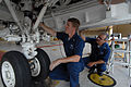US Navy 080612-N-8102J-004 Aviation Structural Mechanic 1st Class Greg Tucker, left, assigned to the.jpg
