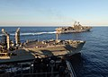 US Navy 080907-N-3392P-216 Sailors aboard the amphibious dock landing ship USS Carter Hall (LSD 50) watch the multi-purpose amphibious assault ship USS Iwo Jima (LHD 7) break away from a replenishment at sea.jpg