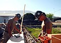 US Navy 081008-N-3560G-379 Builder 3rd Class Andrew Keilholtzl and Utilitiesman 3rd Class James Tofil assemble concrete forms for grade beams.jpg
