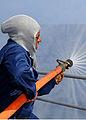 US Navy 081121-N-1082Z-062 Yeoman 1st Class Ella Dukes participates in hose team training.jpg