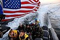 US Navy 090203-N-1688B-035 Sailors assigned to the amphibious transport dock ship USS Nashville (LPD 13) ride a rigid hull inflatable boat to the pier in Dakar, Senegal to prepare for Nashville's arrival.jpg