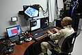 US Navy 090204-N-7676W-115 Marine Corps Sgt. Michael Steele monitors virtual scenarios from the control room of the Gruntworks Research for Infantry Integration Testing.jpg