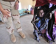 US Navy 090308-N-0506A-256 A boy cries after drinking a dose of the de-worming medication albendazole given to him by members of a joint medical team from Combined Joint Task Force-Horn of Africa during a medical civil action p.jpg
