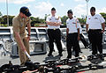 US Navy 090402-N-3666S-076 Ens. Chris Engdahl explains details about the anchor chain to Navy Junior ROTC cadets from Druid Hills High School in Atlanta.jpg