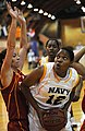 US Navy 090515-N-8726C-001 All-Navy Basketball Team member, Air Warfare Systems Operator 3rd class Arneda Jackson, from Okinawa, Japan, drives the ball to the basket for two points.jpg