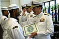 US Navy 090529-N-6680H-021 Vice Adm. Mark E. Ferguson, Chief of Naval Personnel, congratulates a member of the U.S. Navy Ceremonial Guard during a Ceremonial Guard Graduation.jpg