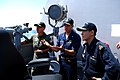 US Navy 090612-N-0869H-143 Rear Adm. Nora Tyson, left, and Rear Adm. Ng Chee Peng, Hellfire missile live-fire exercise.right, Cmdr. Michael McCartney explains a.jpg