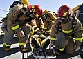 US Navy 090830-N-2638R-003 Junior officers prepare to lift a teammate in a stretcher during a damage control Olympics.jpg