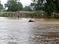 US Navy 100501-N-0000X-003 Streets in the family housing section of Naval Support Activity Mid-South are under water Saturday, May 1, 2010 during major flooding after heavy rains breeched nearby protective levees.jpg