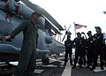 US Navy 100709-N-0995C-024 Lt. Cmdr. Chris Gavin answers questions about the SH-60B Sea Hawk helicopter for Republic of Singapore Air Force pilots.jpg