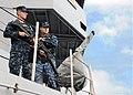 US Navy 101104-N-5620H-029 Gunner's Mate 3rd Class Anton G. Jirik and Gunner's Mate Seaman Apprentice Nathaniel C. Bidet stand watch aboard the sub.jpg