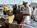 US Navy 110525-N-PO203-029 Paul Gido shows Vice Adm. Daniel P. Holloway some of the give-away items that the Office of Naval Research will hand out.jpg