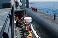 US Navy 110720-N-FG395-025 Navy ROTC midshipmen await transfer from the Military Sealift Command submarine and special warfare support vessel MV HO.jpg