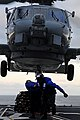 US Navy 110910-N-BC134-700 Sailors connect a cargo pendant to an MH-60 Sea Hawk helicopter.jpg