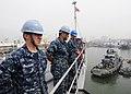 US Navy 111105-N-WJ771-015 Sailors stand by after taking in mooring lines aboard USS Germantown.jpg