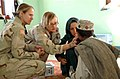 US female specialists treating a young Afghan nomad boy.jpg