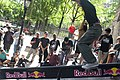 Unidentified skateboarder slides a boardslide down the red bull rail at LES.jpg