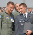 United States and Polish officers at Lockheed Martin's production facility in Fort Worth for the rollout of the first Polish F-16.png