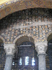 Mosaics with geometric pattern decorate the upper imperial gallery