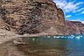 View of the steep coast at Playa De Vueltas black sand beach on La Gomera, Spain (48293845792).jpg