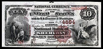 John B. Kendrick - A $10 National Bank Note, Series 1882 Brown Back, from the First National Bank of Sheridan, WY with the hand-signed signature of John B. Kendrick.