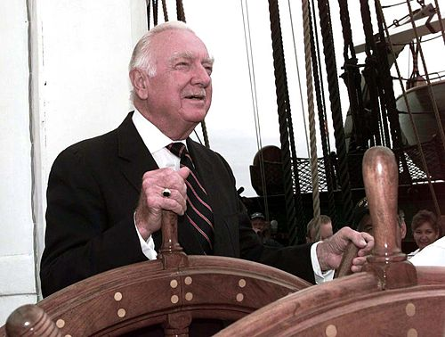 Cronkite at the helm of the USS Constitution in July 1997. WalterCronkiteathelm.jpg