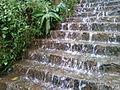 Water flowing through steps on walkway to Simhachalam temple.jpg
