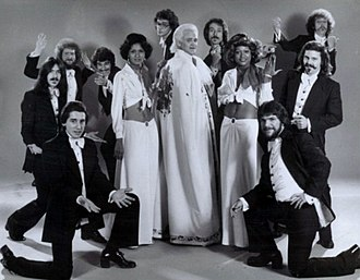 Wayne Cochran - Cochran (in white cape) with the C.C Riders (male backup group) and the Sheer Delights (female backup group), 1977.