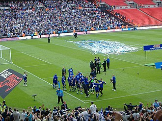 Millwall F.C. - Millwall players celebrating promotion to the Football League Championship at Wembley Stadium.