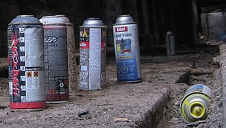 Aerosol paint - A number of aerosol paint cans left at a graffiti site