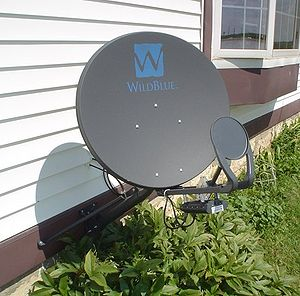 Satellite Internet access - WildBlue satellite Internet dish on the side of a house