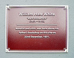 Photo of William Hale White maroon plaque