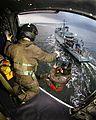 Winchman Lowered onto the Deck of MCM Vessel MOD 45145823.jpg