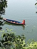 Women sailing her boat for livelihood at begnas lake pokhara .jpg