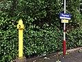 Yellow post and sign at Poynton railway station.jpg