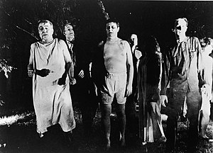 Night of the Living Dead - Ghouls swarm around the house, searching for living human flesh.
