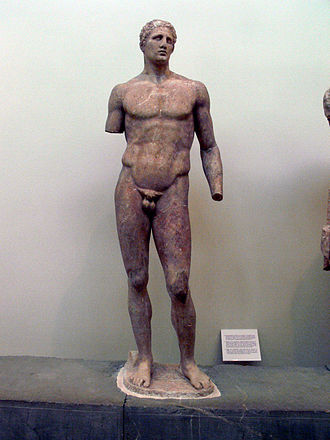 Pankration - A statue of Agias, son of Acnonius, and winner of the pankration in three Panhellenic Games. This statue occupies Position III of the Ex voto of Daochos. Height: 2 metres (6 feet 7 inches)