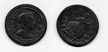 both sides of a small copper coin (the farthing) with a man's head on one side and Britannia on the other