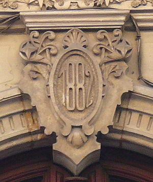 Carrer de Pelai, Barcelona - Building date on a door, on 18 Carrer Pelai.