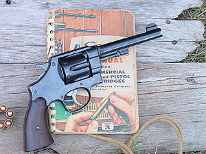 M1917 revolver - Image: 1917 Smith and Wesson with Speer reloading handbook