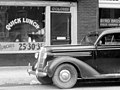 """1940 """"QUICK LUNCH"""" - Colored Door with a Coca-Cola sign - (cropped).jpg"""