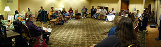Filk music - A Filk circle at a science fiction convention.